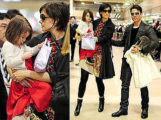Photos of Tom Cruise, Katie Holmes, and Suri Cruise at Narita Airport in Japan