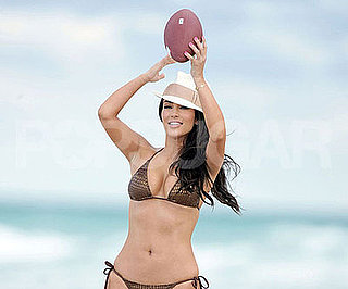 Photo Slide of Kim Kardashian in a Bikini with a Football