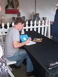 Bobby Flay signing books.