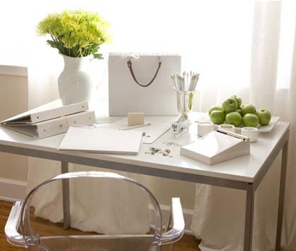 Here, the chair lets the perfect styling of this white office shine. Source