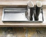 A more industrial tray like this Mudroom Boot Tray ($49) will intercept wet, muddy footwear and keep the mess of the outdoors contained.