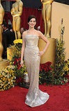 Anne Hathaway is all a glitter in her Armani Privé gown.