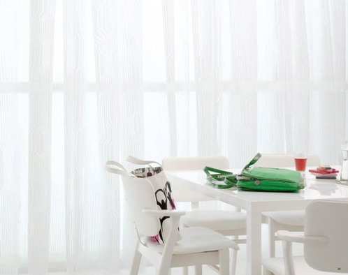 Not a color fan? All white can make an equally fresh impact on your Spring home. Use bright accessories, such as hot-pink glasses, to add small pops of color.