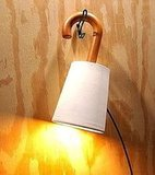 The Wall Lamp ($100) is handmade with a salvaged wooden umbrella handle, and its shade is made from a ceramic planter!