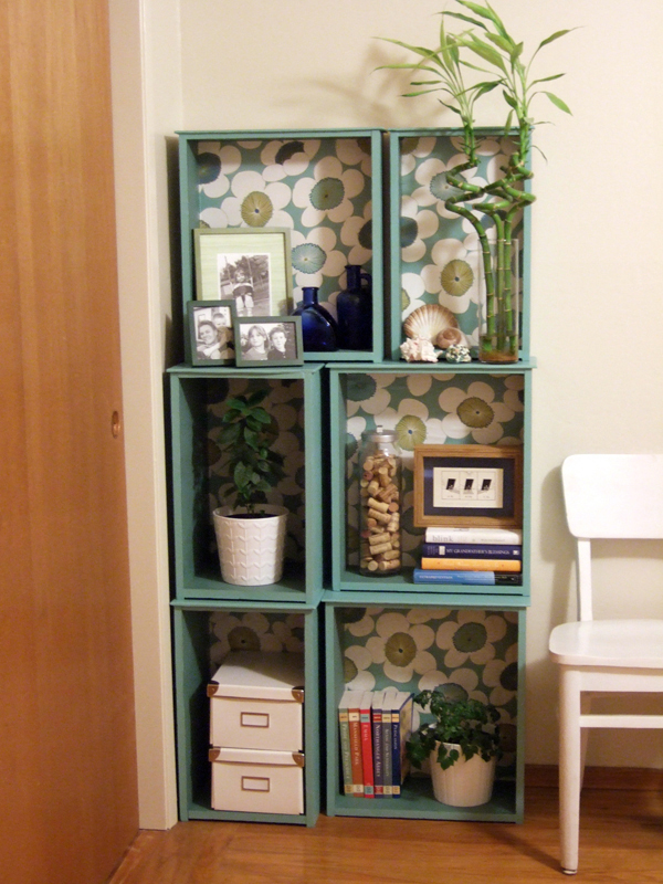 Make a series of storage shelves by screwing together old drawers. Paint the exteriors and accessorize with coordinating wallpaper interiors. So pretty! Look for old drawers at thrift stores, salvage yards, or in the free section in the classifieds.  Source