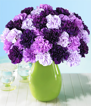 These purple carnations ($39.99 from ProFlowers) really pop against the green vase. I'd stick with the dark purple flowers for maximum impact, though. Can you imagine this bouquet in one shade? It would look amazing.