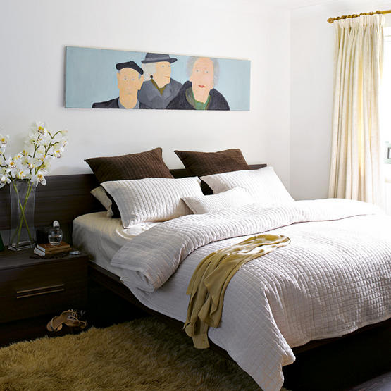 OK, this bedroom does have a bedroom set. But in this case, it's a built-in storage bed, so it's all one piece. To keep it from looking mundane, the owner has added texture with quilted bedding, a shag rug, and drapery. And the painting provides a very personal touch.