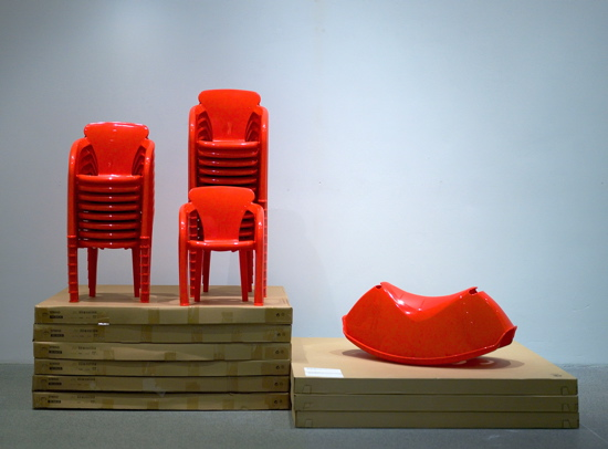 Red and ready for fun, the children's chairs 'Nyfiken, designed by Karl Marnvali in 1995, and children's rocker Rusi, designed by Henrik Preutz in 2007, only need some kids to complete the look.