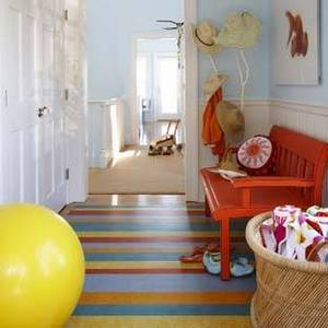 Why stop at the walls? Candy-colored painted stripes look equally cheerful on the floor of this beach house! Source