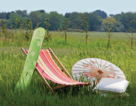 As the weather improves, consider Country Living's suggestion to create an outdoor room with weatherproof furnishings and a parasol to ward off the sun. Source