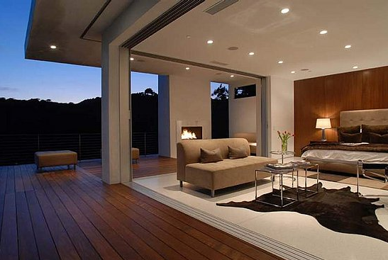 Although Matthew Perry's baller Los Angeles home may be more modern than my tastes usually run, I can't help but drool over this bedroom, the actual walls of which open up onto a gorgeous teak deck, complete with fireplace. Source