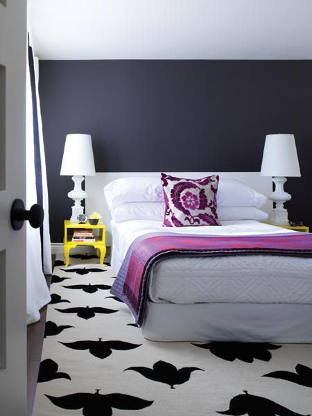 Walker has mixed Ikea side tables, lampshades, and drapes with spendier furnishings like the Madeline Weinrib Black and White Endless Rug and a jacquard throw, proving that if you pick your battles, you can get a luxurious look for less.