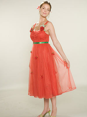 DECK THE HALLS Heigl laughed when she saw this festive red and green dress inspired by the idea of a Christmas wedding.