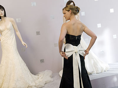 """TAKE A BOW With the white bow strapped across Heigl's backside, costume designer Cat Thomas tried to """"make a really beautiful c"""
